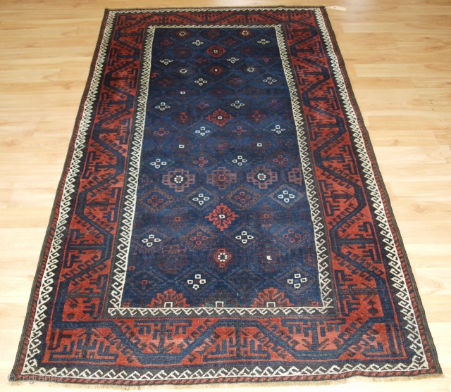 Antique Baluch rug from Western Afghanistan / Eastern Persia. A Baluch rug with a very unusual lattice design in blue.