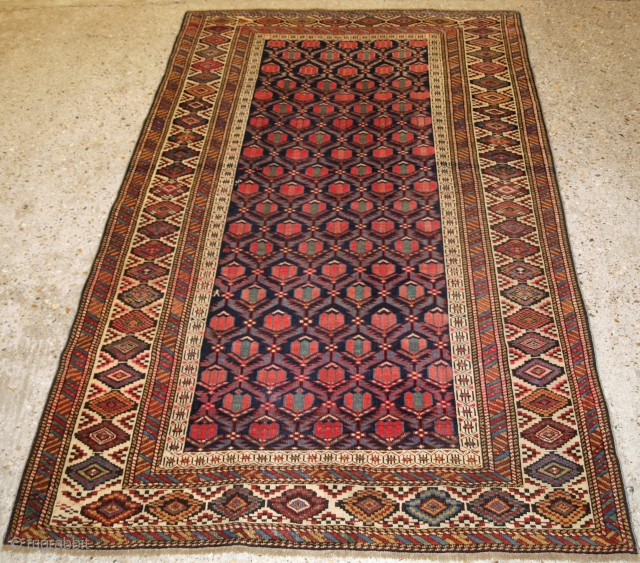 Antique Caucasian Shirvan rug with floral lattice on a dark indigo blue ground. www.knightsantiques.co.uk 