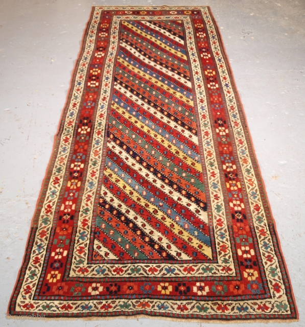 Antique Caucasian long rug with superb colour, 260 x 97cm.
