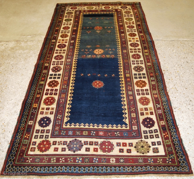 Antique Caucasian Talish long rug with abrashed indigo blue field. www.knightsantiques.co.uk Size: 8ft 2in x 3ft 8in (250 x 113cm). 