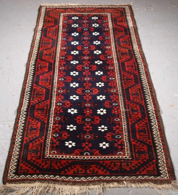Size: 6ft 8in x 3ft 1in (203 x 95cm). www.knightsantiques.co.uk   Antique Baluch rug from Western Afghanistan / Eastern Persia. A Baluch rug with a mina khani design on a dark indigo blue  ...