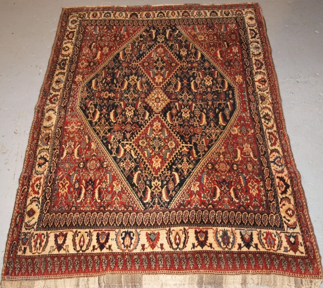 Antique South West Persian Kashkuli Qashqai rug, with triple medallion design, outstanding drawing and colour. The two large medallions and small central medallion are surrounded by a field with the herati design.  ...