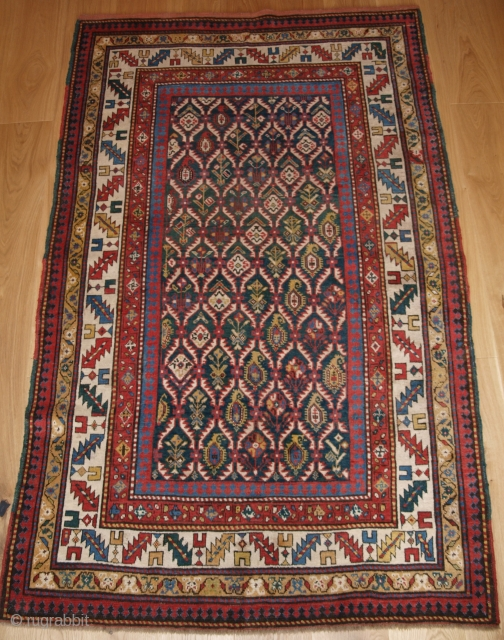 Antique Caucasian Daghestan rug with floral lattice design on a scarce green ground. www.knightsantiques.co.uk Size: 6ft 8in x 4ft 1in (203 x 125cm). 