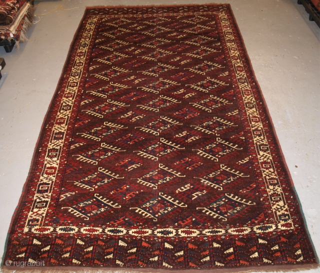Antique Yomut Turkmen main carpet with the 'Dyrnak' gul design and tree design in the elem. www.knightsantiques.co.uk Size: 10ft 3in x 5ft 9in (313 x 175cm). 