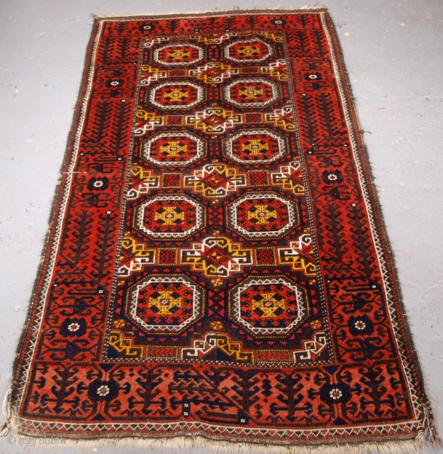 ***Spring sale*** £295.00 click the link www.knightsantiques.co.uk to view more items.  Size: 6ft 2in x 3ft 3in (187 x 100cm).  Antique Salar Khani Baluch rug with turreted gul design.  Circa 1900.  A very nice small Baluch  ...