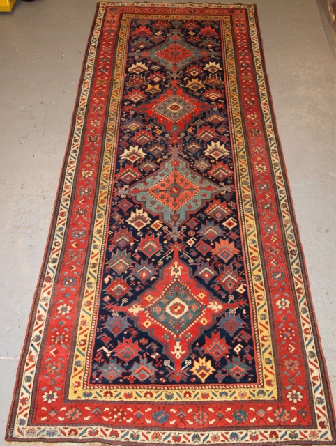 ***Special offer*** click the link www.knightsantiques.co.uk to view more items. Size: 9ft 11in x 3ft 10in (301 x 116cm).  Antique South Caucasian runner with a repeat medallion design.  Circa 1890.  This outstanding runner has four  ...