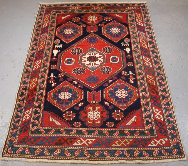 Antique Caucasian Khila rug from the Baku region of the Eastern Caucasus. click the link www.knightsantiques.co.uk to view more items.   Circa 1890.  Size: 5ft 5in x 3ft 8in (165 x 113cm).  This is an  ...