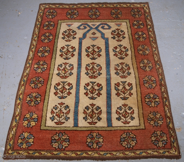 Manastir prayer rug, click the link www.knightsantiques.co.uk to view more items. Size: 4ft 5in x 3ft 3in (135 x 100cm).  Antique Turkish Manastir prayer rug of outstanding simple design with a rams horn  ...