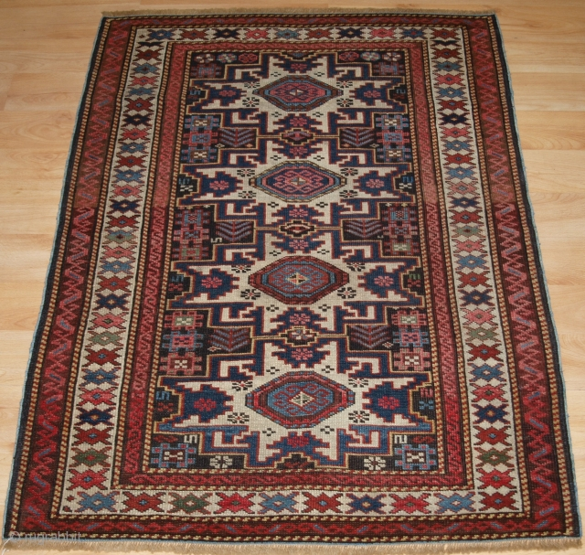 Antique East Caucasian rug with 'Lesghi star' design. www.knightsantiques.co.uk   Circa 1900.  A good small rug with a vertical row of four 'Lesghi' stars. The ivory stars stand out from the dark indigo blue  ...