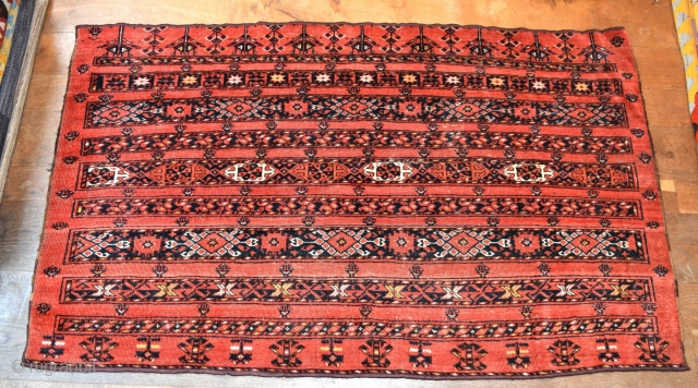An antique Ersari chuval with good natural dyes. Good original condition traces of slight wear/corrosion, slight losses to top and bottom. A scarce piece with good age, clean and tidy, suitable for  ...