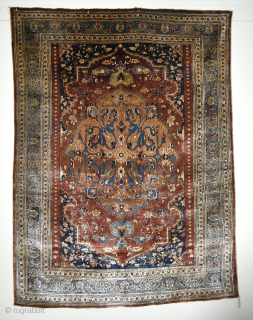 A very Fine antique Heriz Silk rug. A top flight collectable piece woven with beautiful, arabesque filled medallion on soft red ground. The silk on silk rugs are marvels to behold, technically  ...