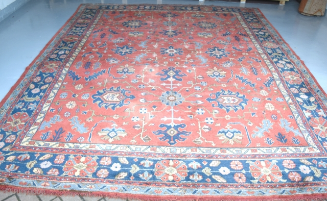 An Old 'Maples' Ushak carpet with soft dyes and allover design in good original condition., just slight wear in places and a few old moth nibbles. Now clean mothproofed and floor ready.