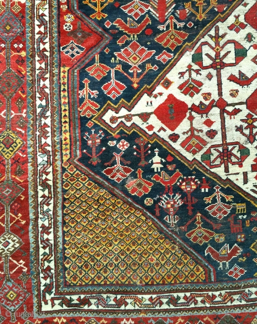 A good antique Khamseh carpet of large proportion. Lots of moth damage on one side, hence great for a restorer. Now deep cleaned and free from the little buggers! 13x5ft. Circa 1880.