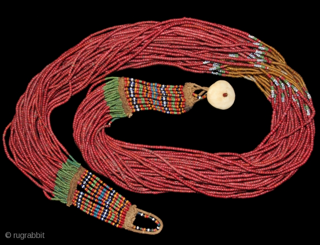 Jewelry Auction Nov 30, 2016: Authentic Naga extra large burgundy whiteheart Royal glass bead necklace with topaz bead center (Est: $6,000/$7,500). 