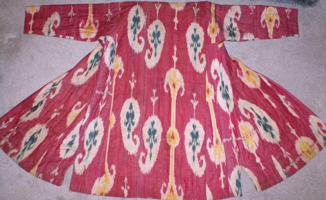 19th century Uzbek Adras Silk wrap/ cotton weft Ikat Chapan ( Coat). Excellent natural colours and bodom gul (almond) design. Beautiful linen, spectacular cross stitches on neck part edges. Reasonable price.   ...