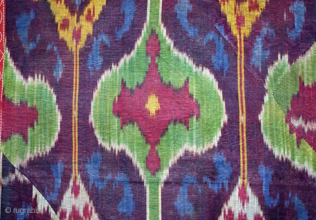 19th cent beatiful uzbek ikat fragment.it has very good veg dyes colours. very unusual desing.the size is 128 by 45cm. for more information please mail me.
