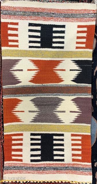 Navajo saddle blanket with unusual colors and strong graphics.  Please ask for additional photos.