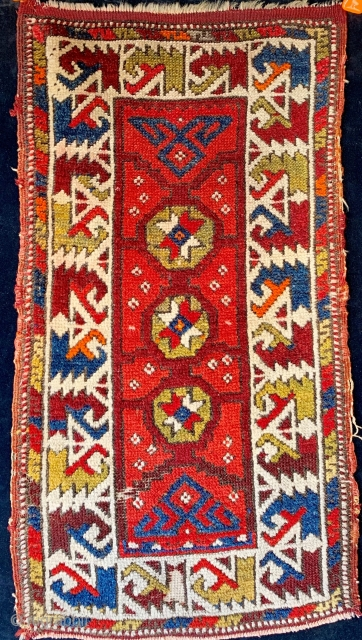 Antique North West Anatolian small yastik from the first quarter of the 20th century, classic border, floppy handle, dyes are a mixed bag.  Please ask for additional photos if needed.