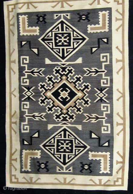 """Antique Navajo """"Two Grey Hills"""", circa 1925-1930, 48"""" by 70"""", all undyed wool, very fine weave (40 to 50 wefts to the inch), in good condition (one small repair to the edge  ..."""