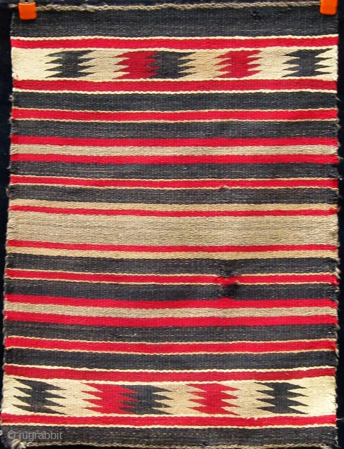 Antique Navajo saddle blanket, circa 1900-1920.  Small repair--worth redoing.  Please ask for additional photos if needed.