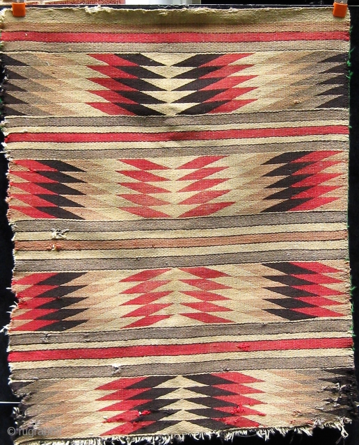 Small antique Navajo rug, circa 1910.  Obvious condition issues.  Please ask for additional photos.