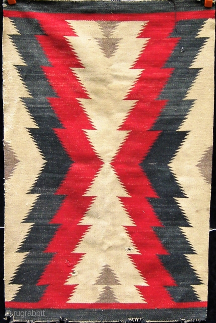 Antique Navajo rug, first quarter of the 20th century.  Some obvious condition issues.  Please ask for additional photos if needed.