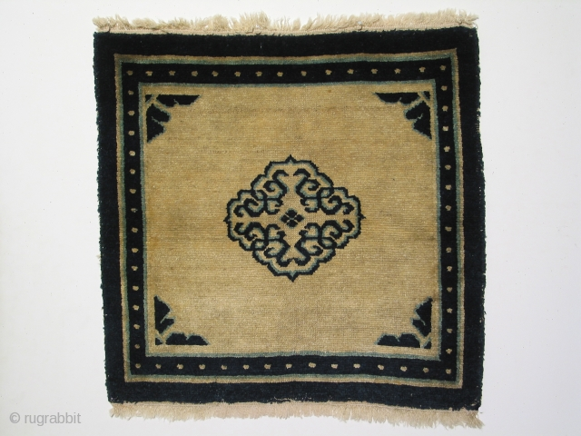 Tibetan mat with very good pile around the perimeter of the mat and reduced pile at the center, 19th century, 26 1/2 x 28 inches.