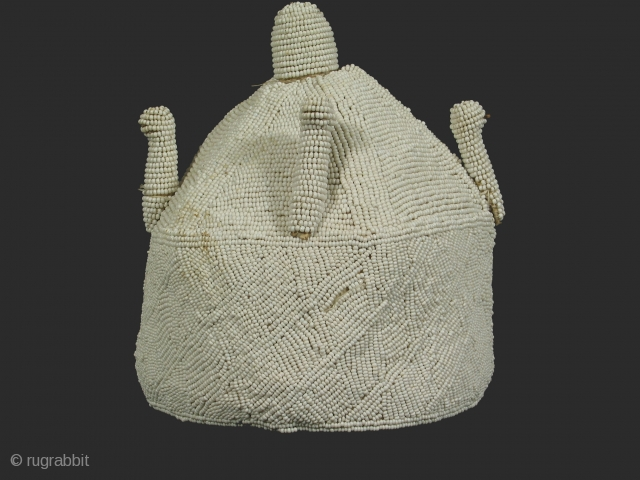 Chief's crown, Yoruba tribe, Nigeria, glass beads and cotton, mid 20th century,diameter 8 inches, height 9 inches. The projections from the upper, conical part of the hat represent birds.
