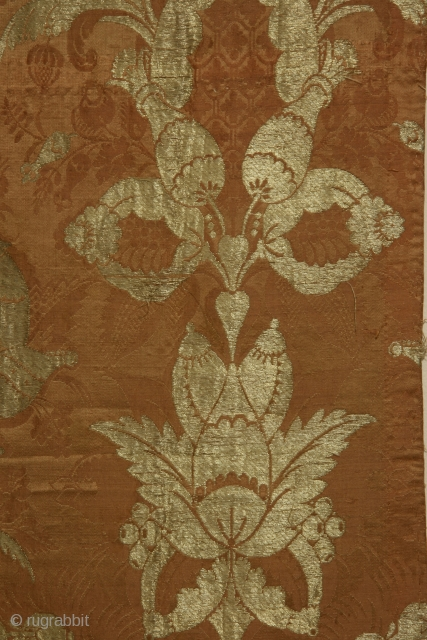 "Silk brocade fabric panel with metallic gold thread of so called""bizzare silk"" type, France or England late 17th or early 18th century, selvedge intact on one long side, 15 x 39 inches."