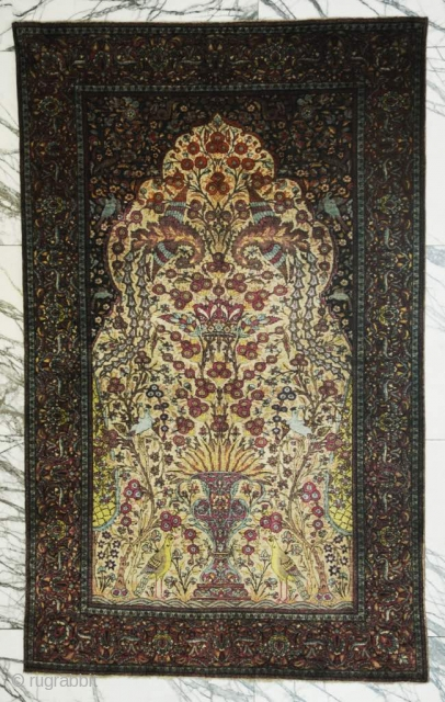 Antuique pure silk Kashan rug.