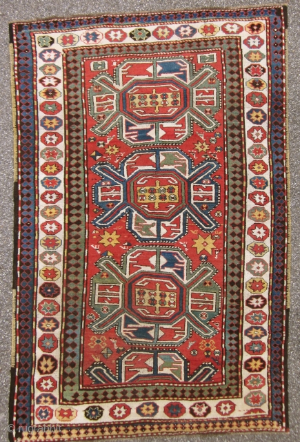 KARABAGH. Antique and well preserved with very limited wear. Almost high piled all over. All borders original.UNIQUE WHITHE BORDER WITH STARS! Size 234 cm x 158 cm