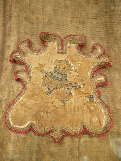 Metal thread and wool hanging, made up of separate pieces attached. Heraldic Crest attached. See photos for condition - various damages including holes, tears and stains. However, this item is in stable  ...