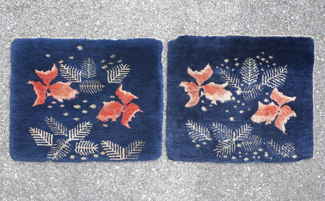 Pair of Baotou sitting rugs with gold fish design. circa 1920.