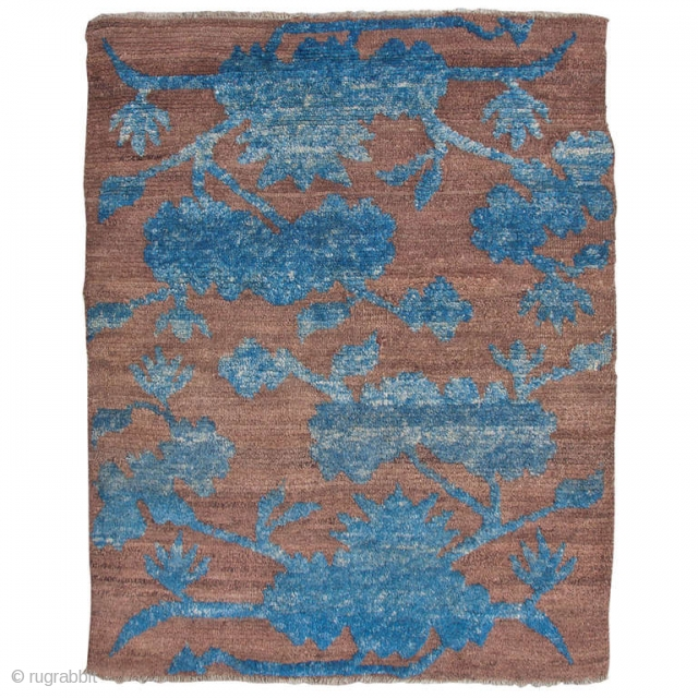 Stunning Tibetan sitting rug. The simple combination of blue lotus flowers and scrolling vines set against a brown background creates the almost three-dimensional quality of the drawing. The strong yet soft Tibetan  ...