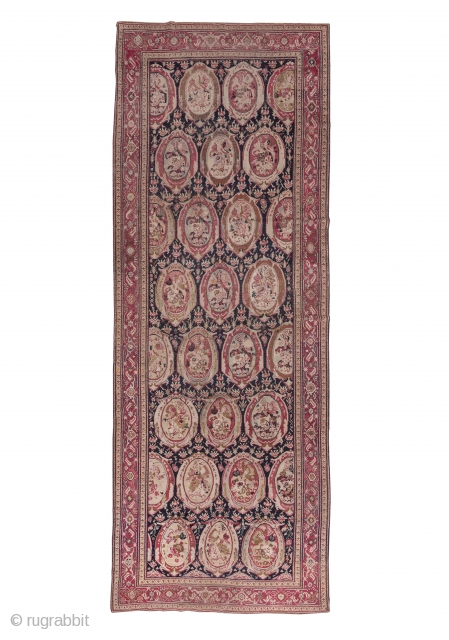 """Karabagh Gallery Carpet  7.1 x 19.2 2.16 x 5.85  This south Caucasian carpet is in the Russian style with columns of elliptical """"mirrors"""" displaying European-style floral bouquets on a contrasting black ground. The cochineal scarlet  ..."""