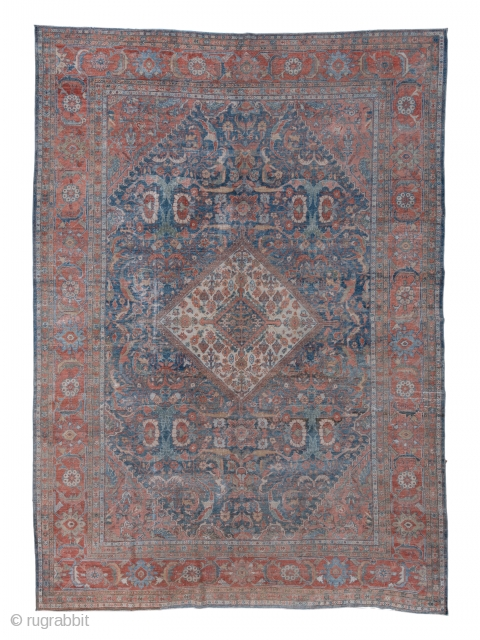 Mahal Carpet  9.0 x 12.3 2.74 x 3.74  The yellowish ivory central lozenge medallion is filled with a scatter of disjoint floral devices and is set on an abrashed slate field decorated with oval rosettes  ...