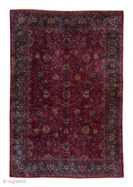 Lahore Carpet  10.0 x 14.8 3.04 x 4.51  The rich raspberry field is decorated by a cloud band, palmette and two-level spiral tendril pattern. The navy border of this northern Indian workshop carpet features three  ...