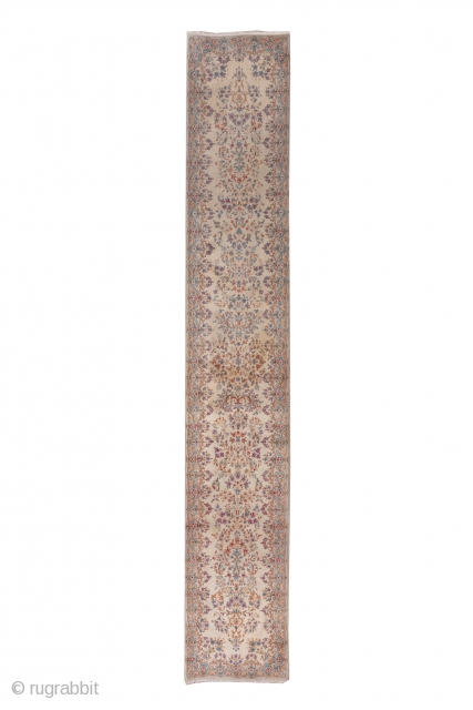 Kerman Runner  2.8 by 16.3 0.85 x 4.96  This full pile SE Persian runner with an ivory ground, broken border and tones of  warm red, powder blue, light blue, rust and goldenrod displays vases  ...