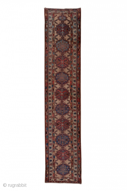 Sarab Runner  3.3 x 15.1 1.00 x 4.60  The light camel-tone field of this well-woven rustic NW Persian runner displays 10 characteristic  Sarab hooked  cartouche medallions formed into a central pole device. The medallions  ...