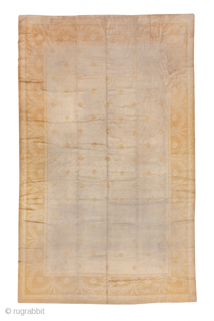 Savonnerie Carpet  10.6 x 17.1 3.23 x 5.21   This French high-pile carpet is a study in cream and softest gold with an open, plain field within a pastel lemon border with laurel swags and  ...