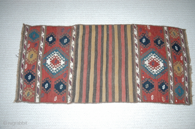 "Shahsavan mafrash end panels (each 21""X 15"") salvaged from damaged mafrash and sewn to part of bottom as wall hanging (overall dimensions 45""X 21"") 19th C. Natural dyes. Excellent condition."