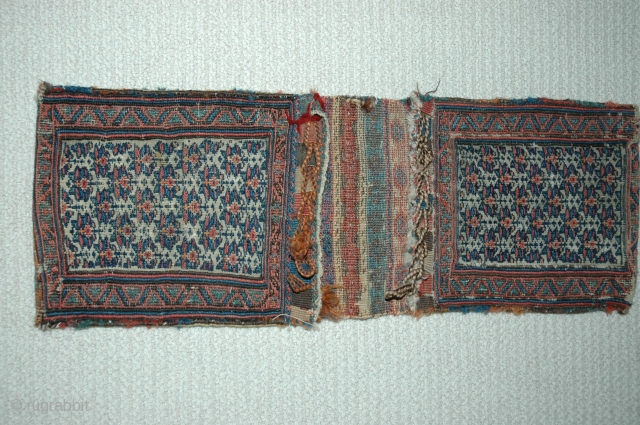 Shahsavan chanteh khorjin third quarter of 19th C 35&quot;X 13&quot; bud and flower design, soumac and brocade face and partition, plainweave back, good condition,  This is an unusually early example of  ...