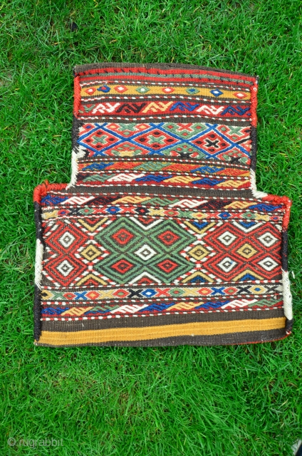 Kurdish salt bag, 20 in. X 18 in. Early 20th C. Wool. Brocaded face, beautiful striped back. Deeply saturated natural dyes. Excellent condition.
