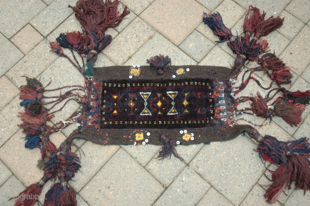 "Baluch horse or mule chest trapping first quarter of 20th C 19"" X 11"" Wool pile, goat hair band, serene blue and purple tassels, silk highlights and added amulets; back with partial  ..."