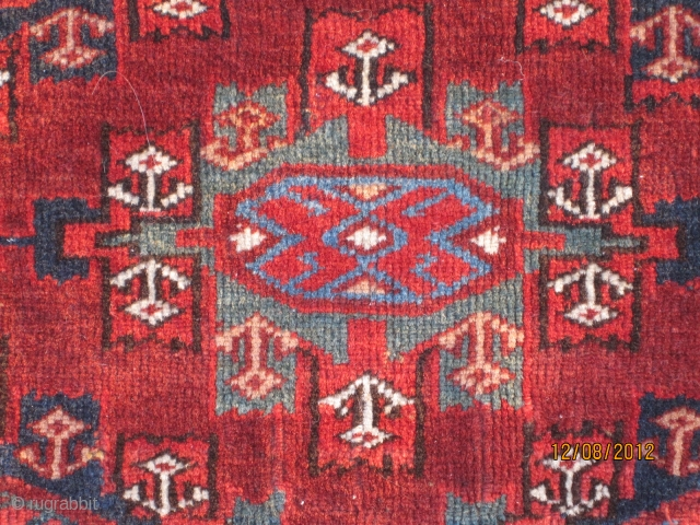 Yomut torba, circa 1870, with Kepche gul, finely woven, with brilliant green and blue, unusual border design, in excellent condition.