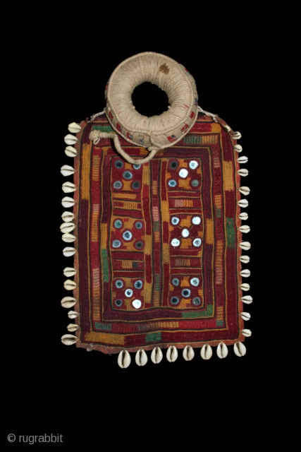 Banjara Gala,Gaadi and Pulia From Karnataka, Telangana,India.C.1910.The pulia has an outside cowrie border,internal lines of cowries and each square element has a mirror work.Its size is 21cm X 30cm.(DSL02250).