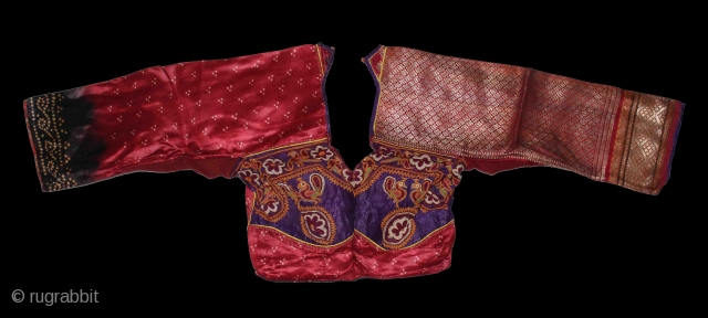 Child's(choli) from Bansali Community,kutch,Gujarat india early 20th century. Left side panel used Amar Brocade. Right side panel used Aba Silk Fabric.Perfect condition.(DSC01225).
