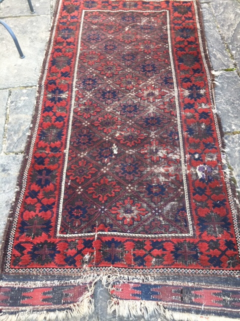 19th century Belouch rug, in distressed condition. Stunning wool quality and good saturated colours, with non-typical design. 210cm by 104cm (7ft by 3ft 6in)