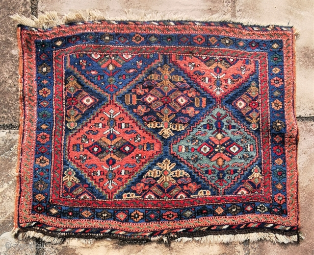 1930's Afshar bagface with a design more typical of rugs. Full pile save a small area of moth damage. Would benefit from a clean 33in by 27in