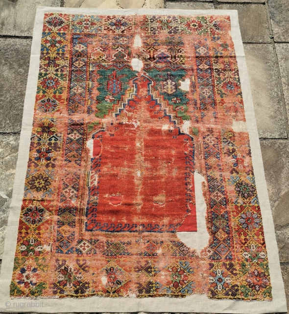 18th century Mujur rug, with stunning colours, but showing its age.  Superbly well mounted. 68in by 47in